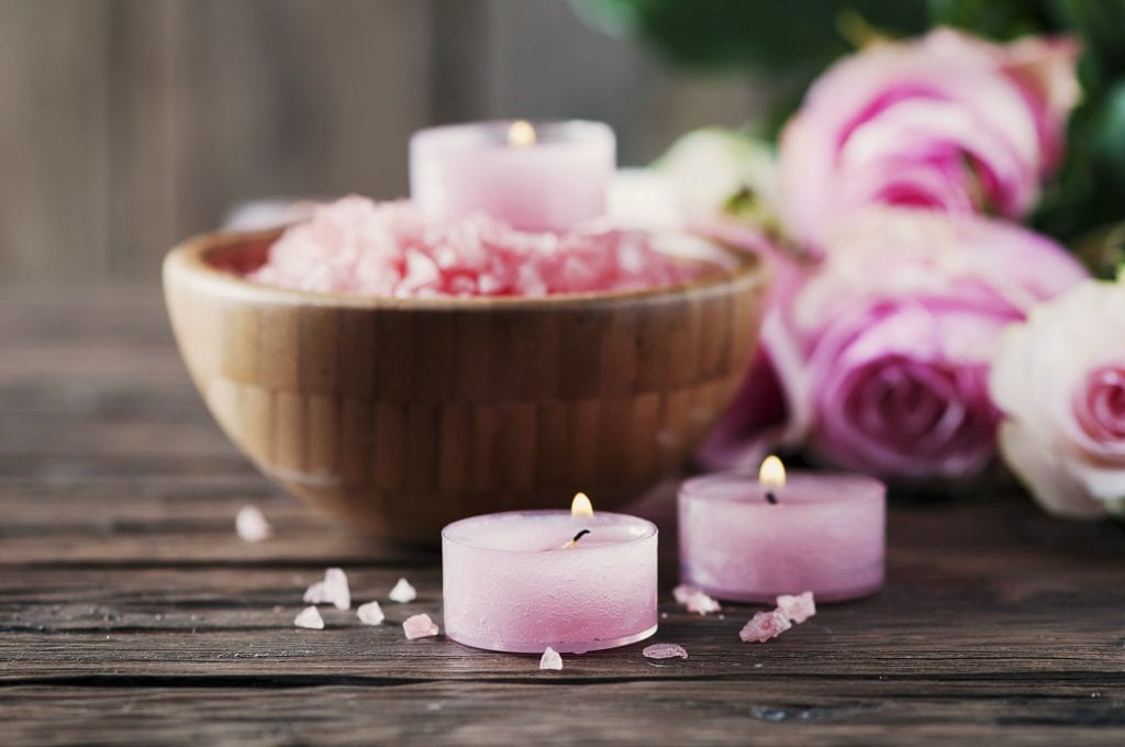 SPA treatment with pink salt and candles